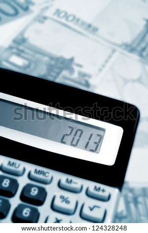 number 2013, as the new year, on the display of a calculator, with some euro bills in the background