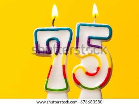 Number 75 Birthday Celebration Candle Against A Bright Yellow Background 676683580