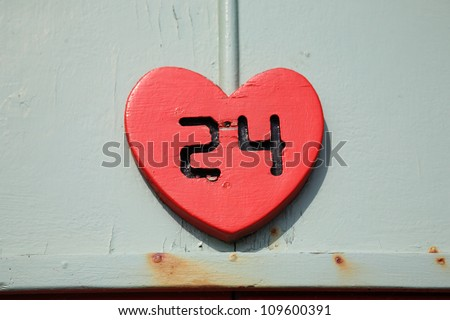 Number 24 cut into a red heart shape England