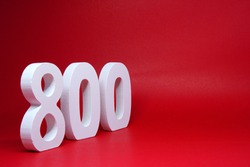 Number 800 ( Eight hundred ) Isolated red  Background with Copy Space -  800% Percentage or Promotion - Discount or anniversary subscribe concept