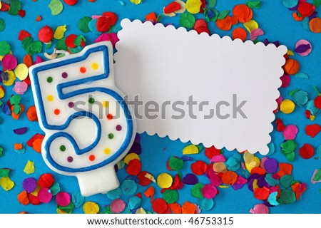 Number five birthday candle on blue background