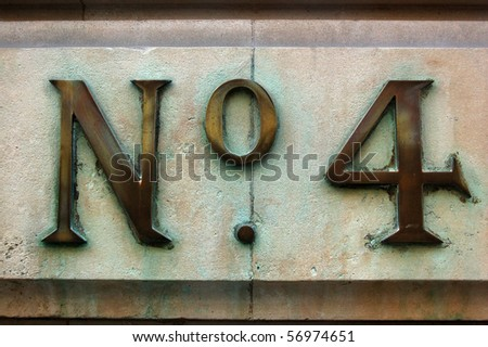 Number Four A sign for the number four on the outside wall of a Georgian office block in the City of London