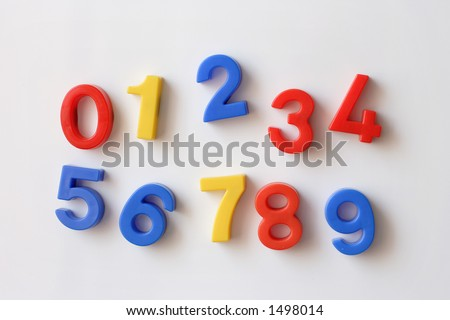 number fridge magnets displaying numbers 0 - 9, messy