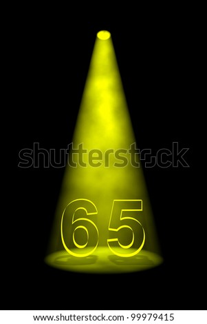 Number 65 illuminated with yellow spotlight on black background