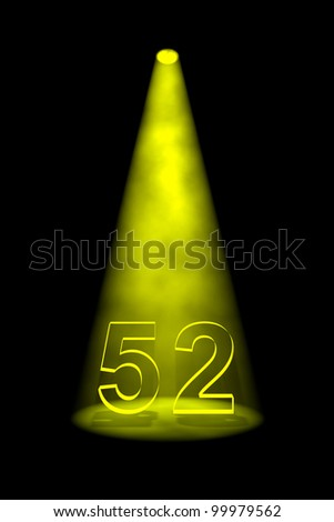 Number 52 illuminated with yellow spotlight on black background