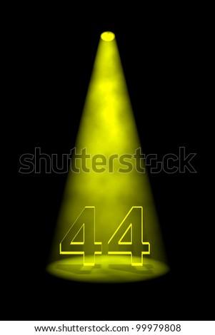 Number 44 illuminated with yellow spotlight on black background