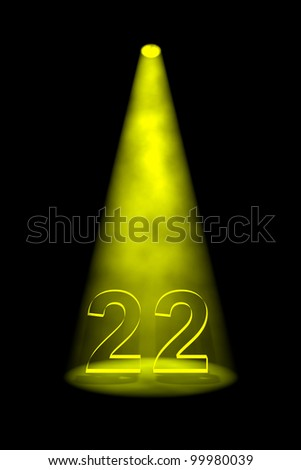 Number 22 illuminated with yellow spotlight on black background