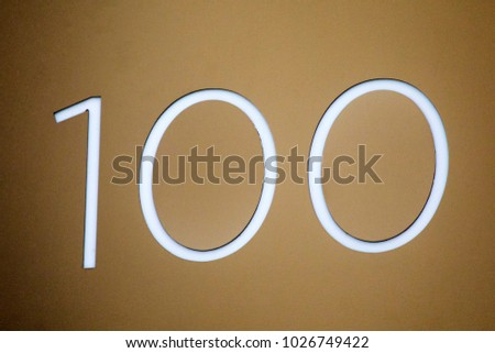 Number 100 lettering on a wall. #1026749422