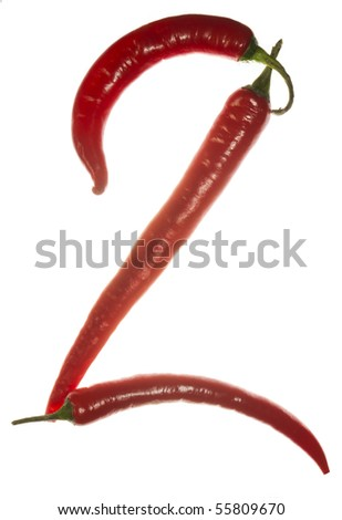 "Number ""2"" made of chili peppers on white background"