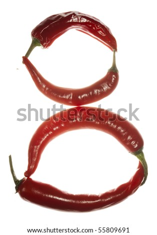 "Number ""8"" made of chili peppers on white background"