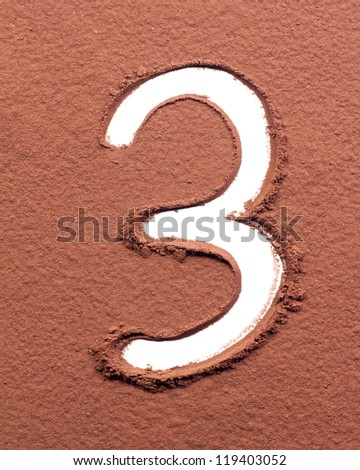 Number 3 made of cocoa powder on white background - stock photo