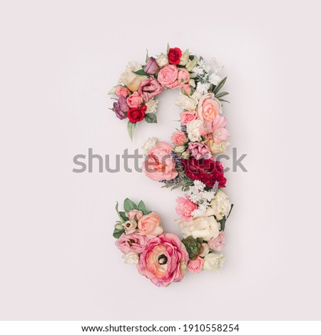 Number 3 made of real natural flowers and leaves. Flower font concept. Unique collection of letters and numbers. Spring, summer and valentines creative idea. stock photo