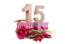 Number of age in a colorful studio setting and Dutch looking attributes like a clog wooden shoe and tulips