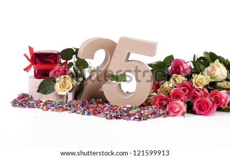 Number of age in a colorful studio setting with fresh roses on a bottom of confetti