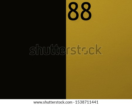 Number 88 on a black-yellow background.