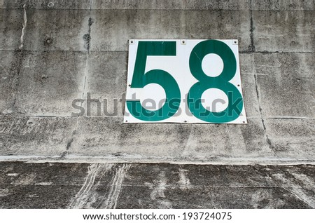 Number 58 on a concrete wall, Concept for number, Background with number