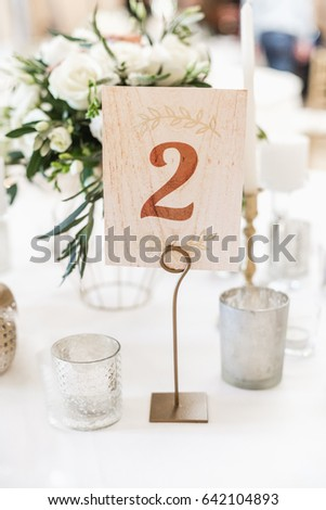 Number on a table in restaurant. Festive banquet. #642104893