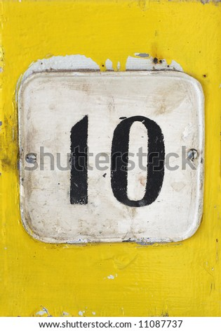 Number '10' on an old sign