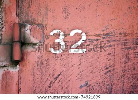 number 32 on old door