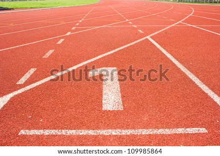 number 1 on red running track - stock photo