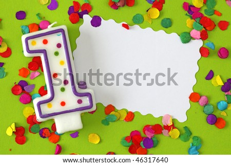 Number one birthday candle on green background
