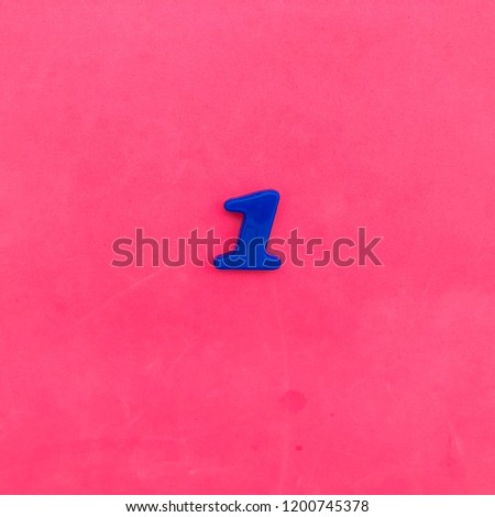 Number one. Number 1. Blue on pink background. Minimal. #1200745378