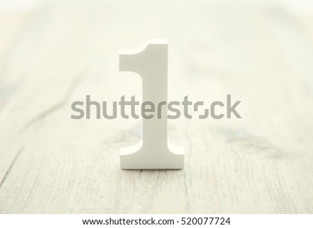 Number one on rustic wooden background. Top concept. Wooden number 1 as symbol of success #520077724