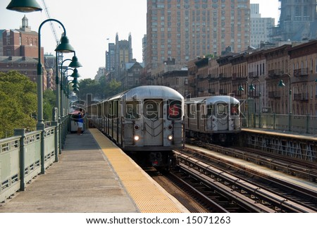 Number one subway train approaching the 125th street elevated station in Manhattan, New York City