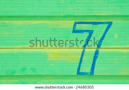 number 7 painted a battered metal door