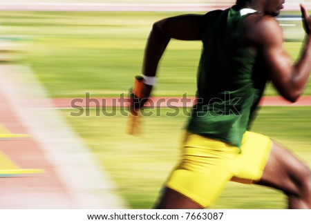 Number 4 runner in the 4x100 relay race. - stock photo