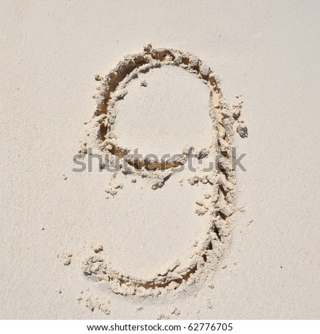 Number 9. Sand Alphabet: digits. Concept holiday background.