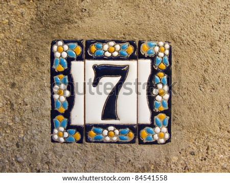 Number seven in a ceramic tile on street