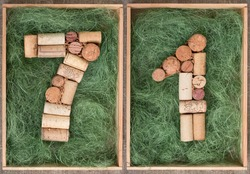 Number 71 seventy one  made of wine corks on green background in wooden box
