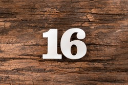 Number sixteen - White Piece on Rustic Wood Background