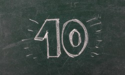 Number ten on chalkboard, blackboard texture