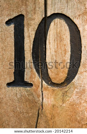 Number ten on cracked wood board