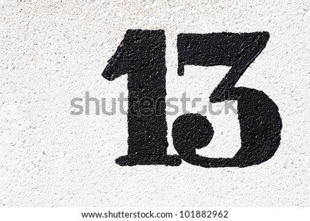 number thirteen painted on the wall