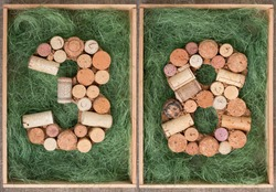 Number 38 thirty eight made of wine corks on green background in wooden box