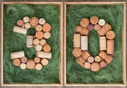 Number 30 thirty made of wine corks on green background in wooden box