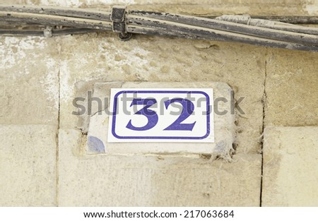 Number thirty-two on the wall of a house, number of information, even number