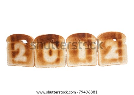Number 2012 toasted on white bread isolated on a white background.