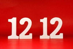 Number 12 12 Twelve and Twelve - Date Month December  Promotion Concept on red background - Birthday sale and Shopping Day sale