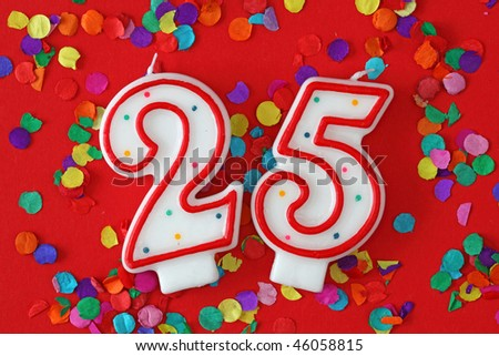 Number twenty five birthday candle on red background