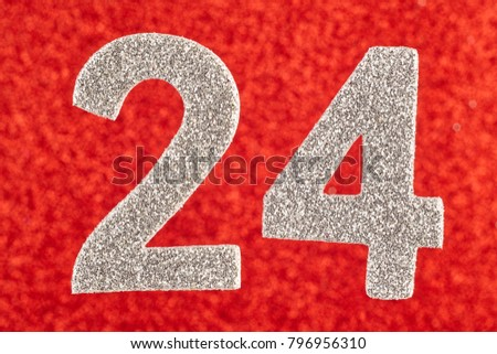 Number twenty-four silver color over a red background. Anniversary. Horizontal #796956310