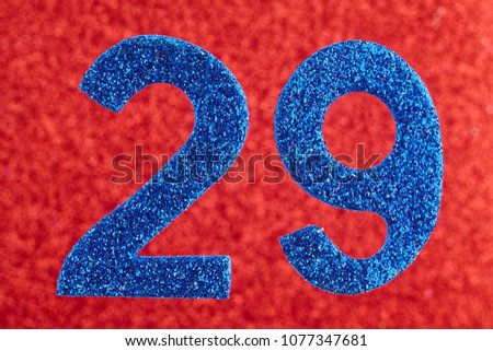 Number twenty-nine blue color over a red background. Anniversary. Horizontal #1077347681