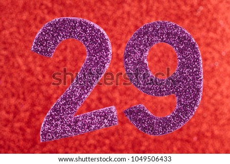 Number twenty-nine purple color over a red background. Anniversary. Horizontal #1049506433