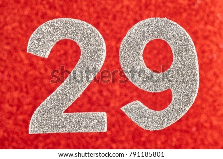 Number twenty-nine silver color over a red background. Anniversary. Horizontal #791185801