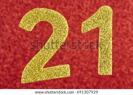 Number twenty-one golden over a red background. Anniversary. Horizontal #691307929