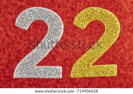 Number twenty-two silver gold over a red background. Anniversary. Horizontal #714906028