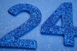 Number twentyfour blue color over a blue background. Anniversary. Horizontal